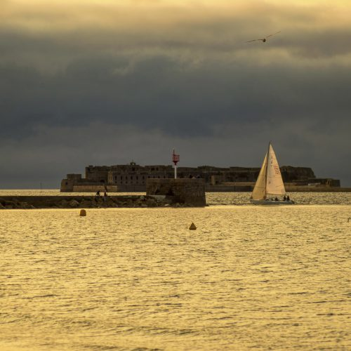 Cherbourg-Octeville, France - August 21, 2018: Sailboat in the harbor of Cherbourg during sunset. Normandy, France